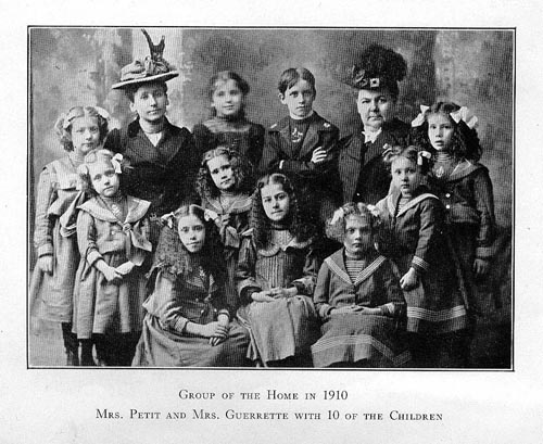 Image of Mrs. Petit and Mrs. Guerrette with 10 of the Children in 1910
